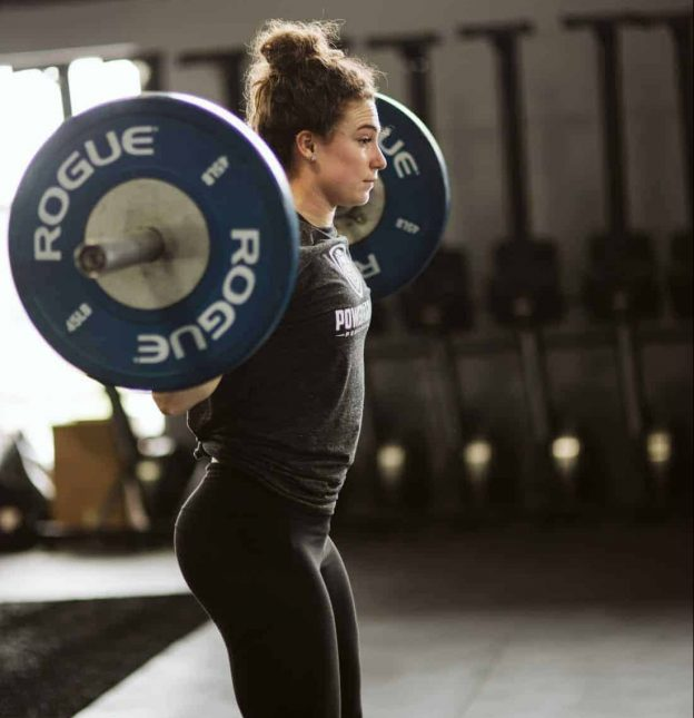 woman power lifting gym